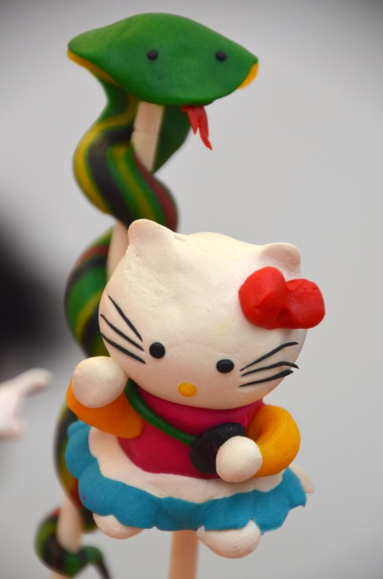 snake and hello kitty figures