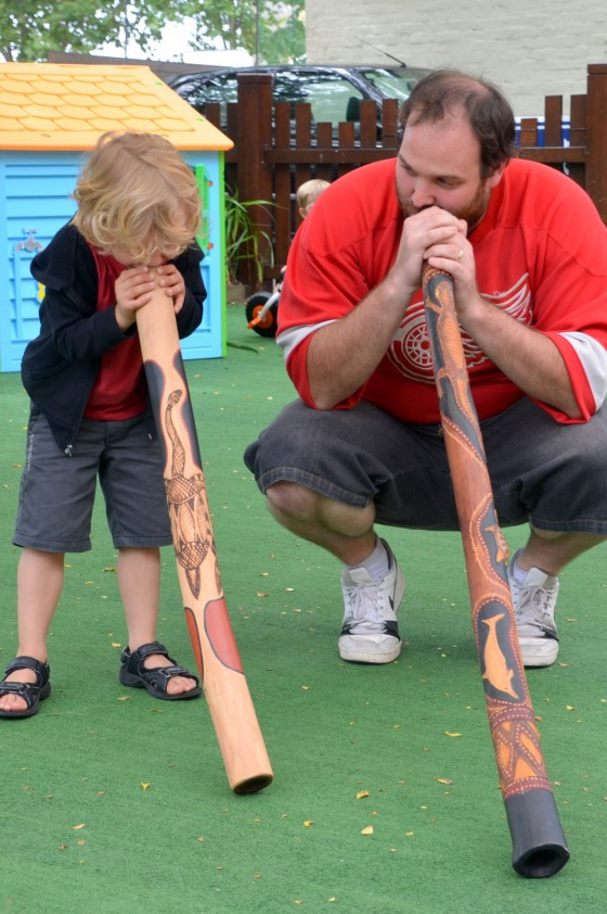 Kids playing didgeridoo