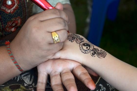 Henna painting at Holi