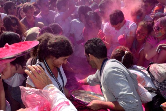 The crowd goes wild as the colour flies at Holi