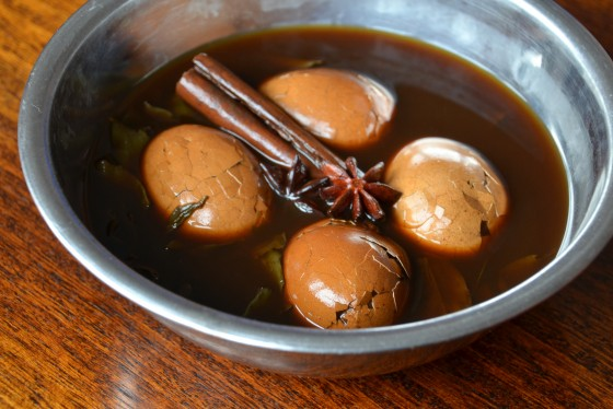 Tea eggs soaking in soy, tea and spices