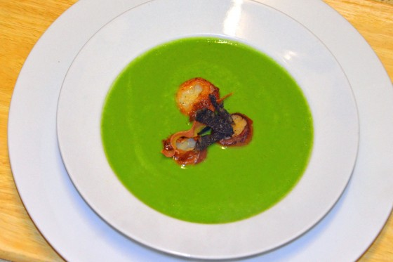 Pea and baby spinach soup with scallops, prosciutto and truffle