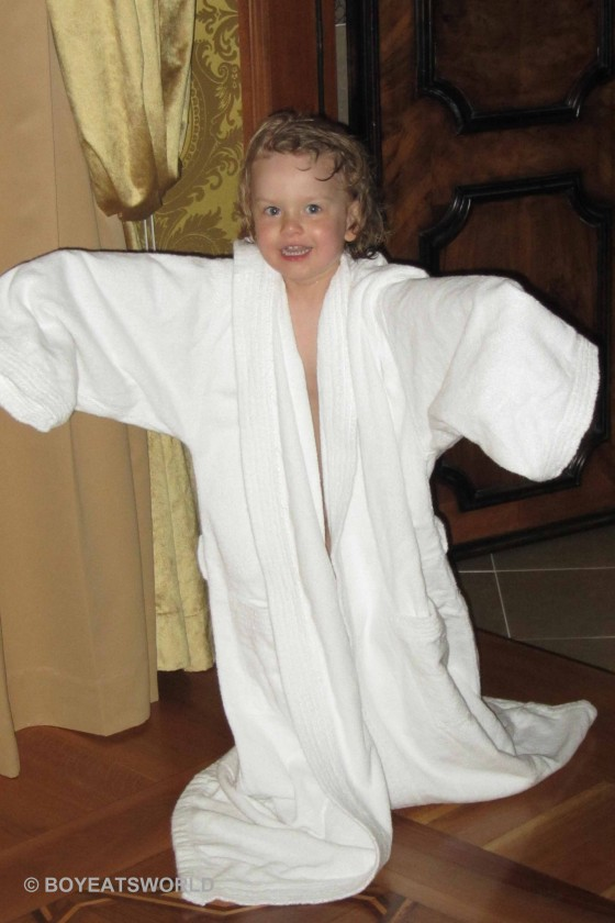 kid in an oversize hotel robe