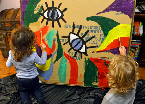Kids painting on cardboard