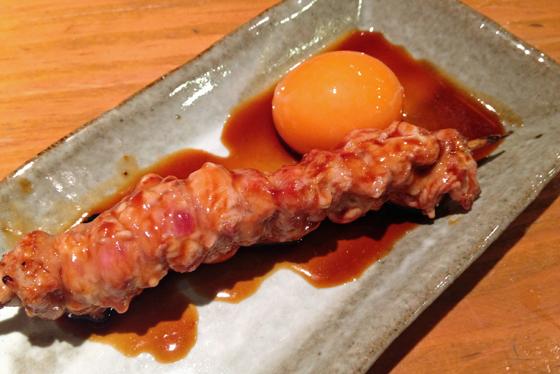 Chicken bits with raw egg yolk, tokyo