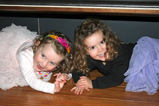"The girls hiding under a seat to avoid being ""eaten"" at Tyrannosaurs at the Australian Museum"