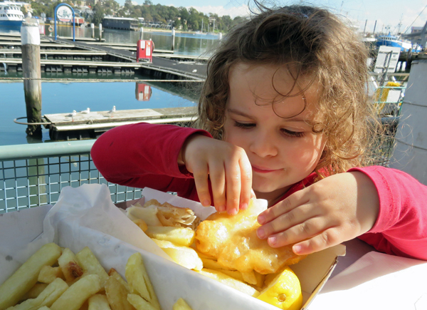 Kid eating fish and chips