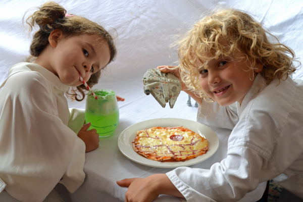 the kids dining on Dagobah swamp juice and death star pizza
