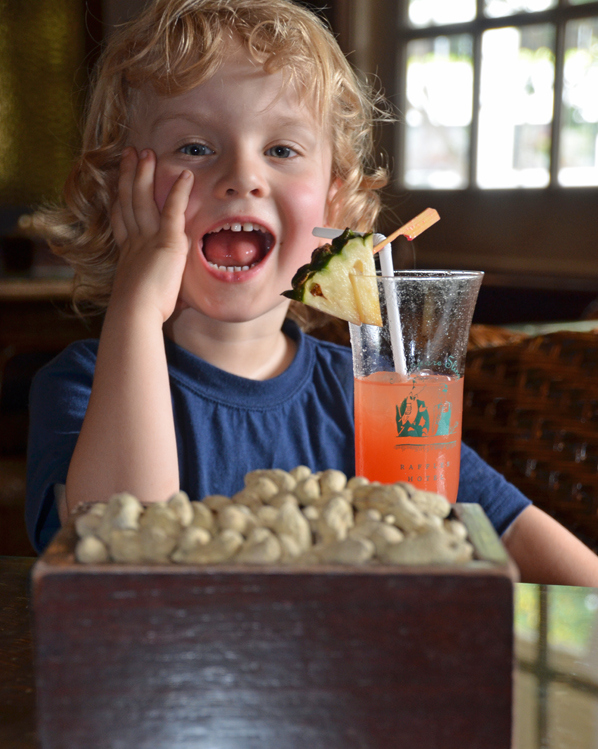 Kids with a (virgin) Singapore Sling at the Long Bar, Raffles SiIngapore