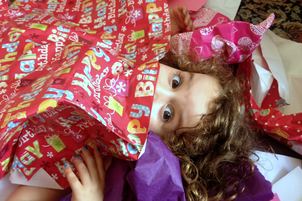 kids in wrapping paper