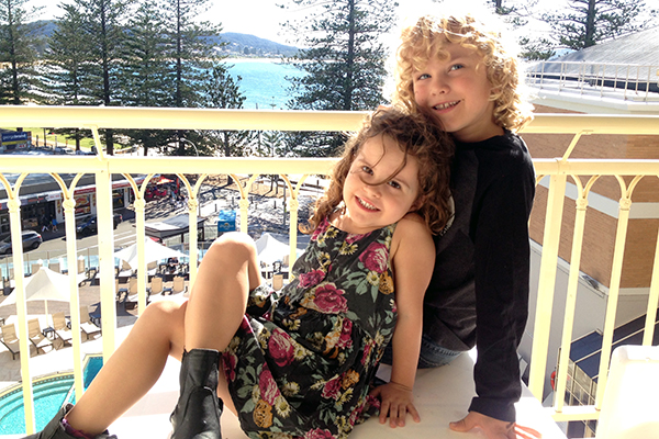 soaking up the sun on the balcony of our guest room at Crowne Plaza Terrigal