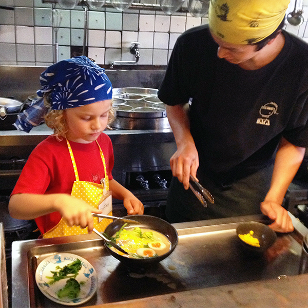 Kids in the kitchen at Menbakaichidai Ramen University, Kyoto.