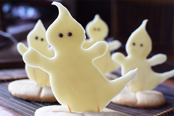 White chocolate ghosts releasing themselves from soul cakes for Halloween