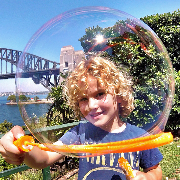 Boy in a bubble. A tiny bubble goes large with a GoPro wide angle