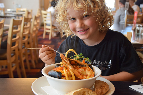 The boy eating Bouillabaisse at The Spotted Cow Toowoomba