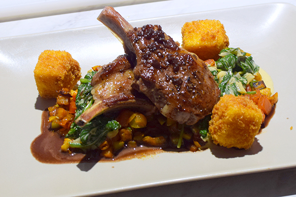 Benny Masekwameng's lamb chops with a cream spinach with ground nuts and chilli and crumbed mealie pap at Taste of Sydney