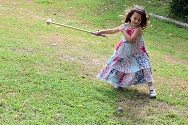 The kid sloved the croquet set at Sugarpuff's Mad hatters Tea Party