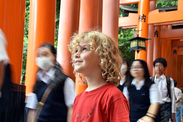Young blonde boy at Fushimi Inari Shrine in Kyoto