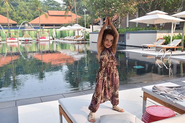 Sugarpuff strikes a pose poolside at the SOfitel Singapore Sentosa Resort & Spa