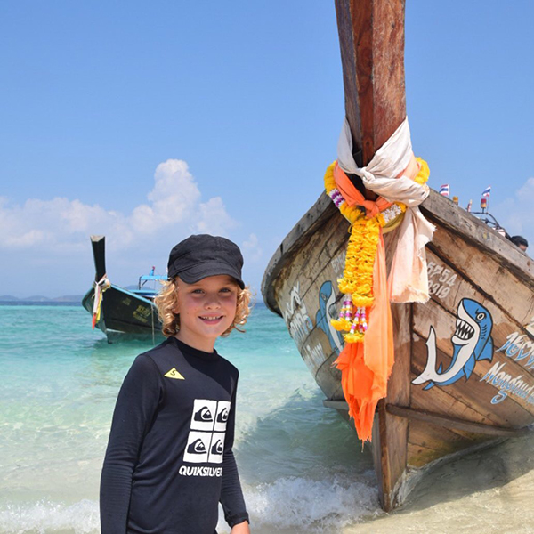 Raffles loves the long boats; Raffles loves getting up close with the eleventy billion fish: Koh Khai Nok with kids