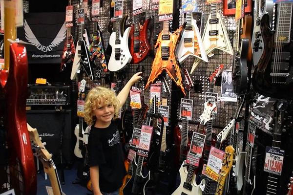 He's keen on this flame-strewn metal monster in Ochanomizu, Guitar Street
