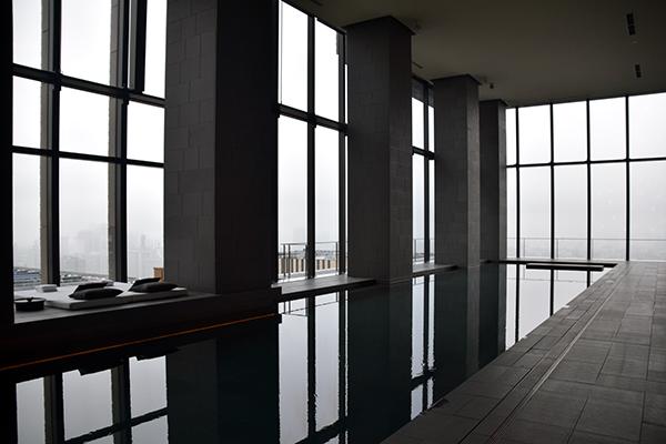 Aman Tokyo's gorgeous black basalt swimming pool