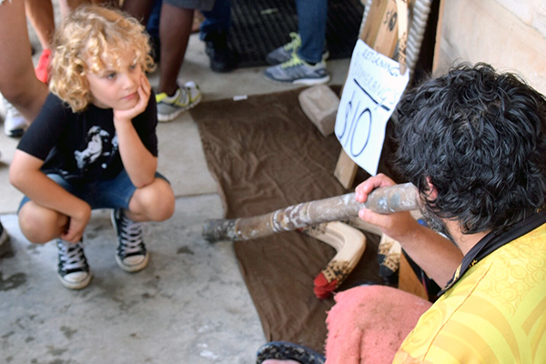 Raffles gets a few expert tips on playing the Didgeridoo at Blak Markets, Sydney