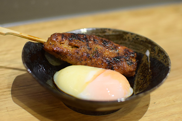 Chicken meatball with sweet soy and a 63 degree egg at Yakitori Yurippi Crows Nest