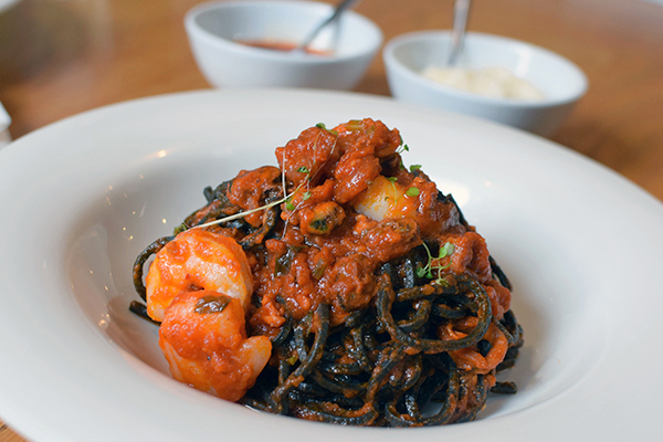 Squid Ink Pasta in Marinara Sauce at Adamo's Pasta Rosebery
