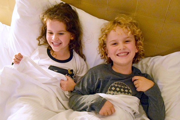 Snuggling up for movies in bed on a Novotel Staycation
