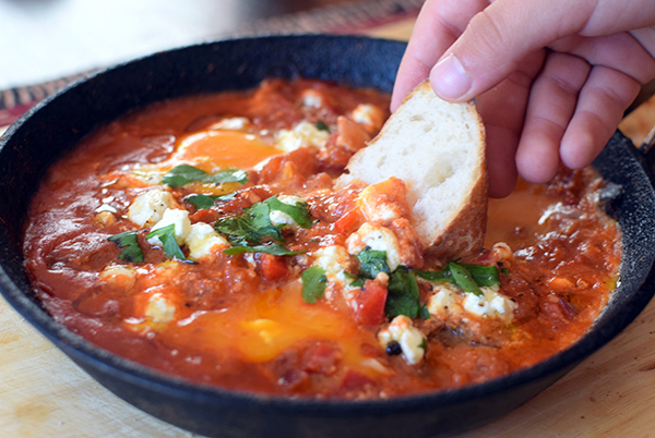 Shakshuka with feta and merguez sausage with crusty toasted bread