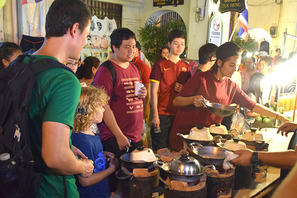 Queuing for more street eats with Migrationolgys Mark Wiens at Phuket Walking Street market