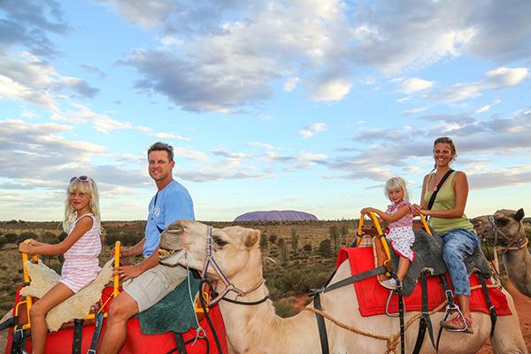 Kalyra and family riding camels at Uluru - photo courtesy of Ytravelblog.com
