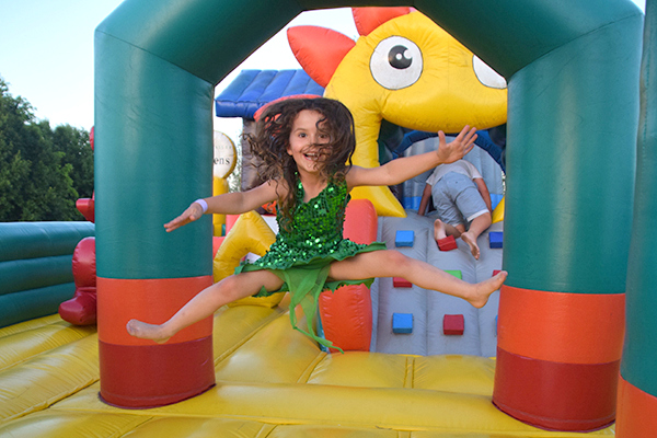 Learning to fly on the bouncy castle at Hunter Valley Gardens
