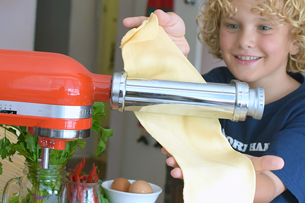 Raffles rolling pasta on the KitchenAid Mini