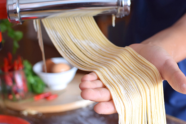 beautiful strands of fressh pasta from the KitchenAid Mini pasta attachment - Boyeatsworld
