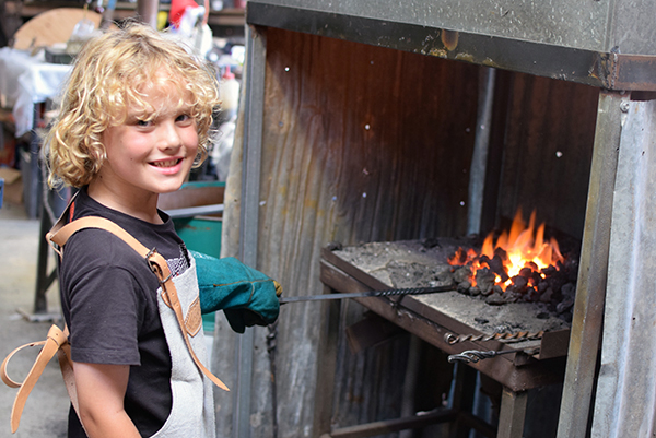 Hartley Historic Village with Kids: Raffles hard at work on his firepoker at Talisman Gallery, Little Hartley