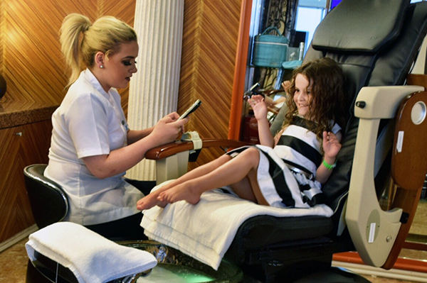 Getting pampered at the day spa: Carnival Spirit by kids