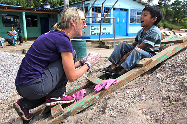 Meeting the locals on a voluntour bottle school building project with DreamTrips