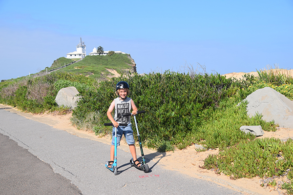scootering to Nobbys Lighthouse