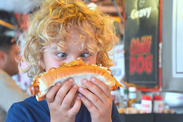 Devouring the Chilli Dog at Harry's Cafe De Wheels