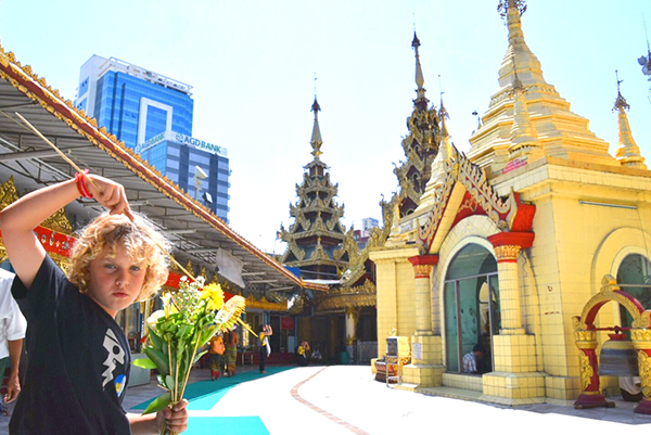 Raffles is wrapped to discover that Mondays child is born to travel at Sule temple Yangon #escapers17