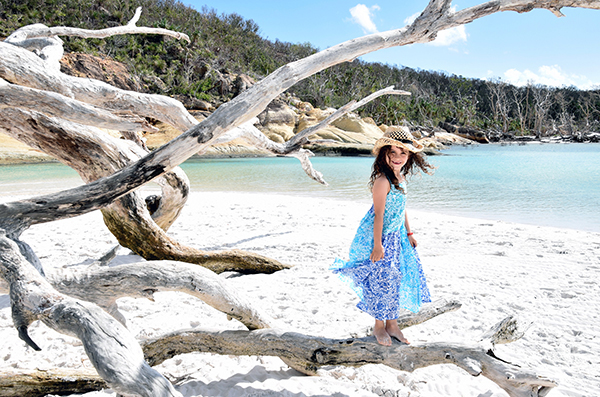 Whitsunday Islands with Kids. Girl on Whitehaven Beach. BoyEatsWorld