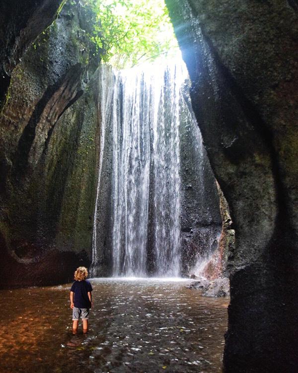Bali by kids: Tukad Cepung, a hidden waterfall near Ubud