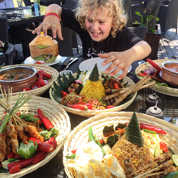 Bali by kids: Diving into a feast of rice and satay at the beach
