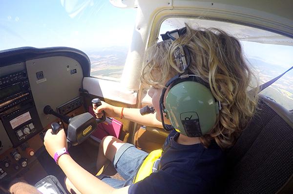 Kids flying a plane