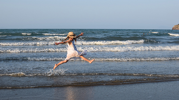 Frolicking in the waves at Casuarina Beach, Cape Hillsborough