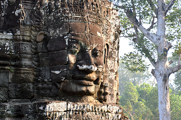 One of the 216 giant faces ta Angkor Thom