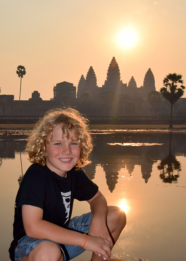 Angkor Wat kid at sun rise