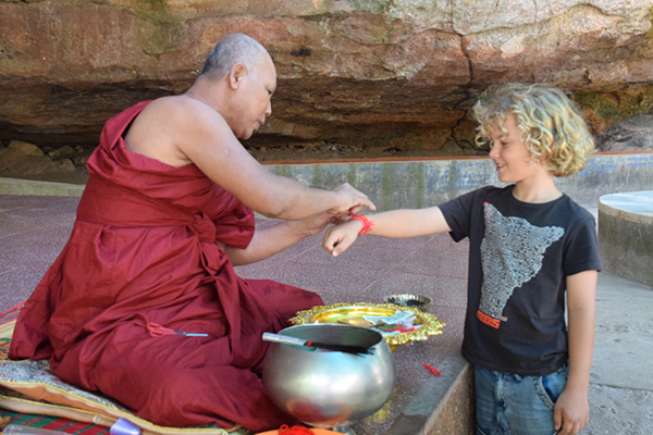 Receiving blessings at Preah Ang Thom, Siem Reap